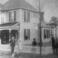 Charles and Fanny Drace at their home, 210 West Arlington Avenue. Though hard to see in this image, Charles is standing beside a baby carriage with daughter Pearl Drace.