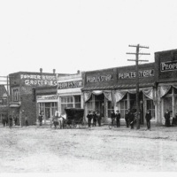 Marchant house visible on the far left behind Peoples Store and Power Bros. Gro., c. 1904