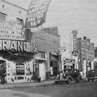 Laundry and Western Union, nestled between the Grand Theatre and Ponder's Ice Cream, 1938